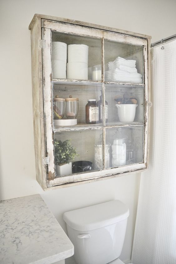DIY antique window cabinet- See how to make this super easy antique window cabinet. Great for bathroom storage or any room in your home!: