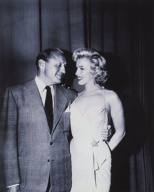 » Jack Benny and Marilyn Monroe, 1955  She doesn't seem to mind that he's staring at her chest. Oh well. She must have gotten used to it.