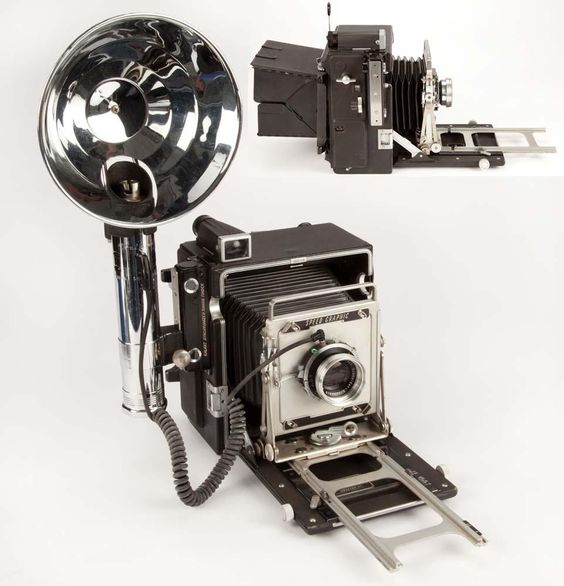 """Clarence Sinclair Bull's complete working 4 x 5 Graflex """"Speed Graphic"""" camera and accessories"""