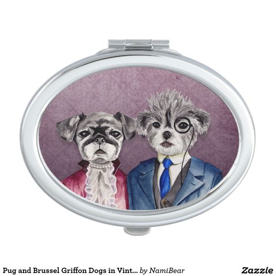 Compact Mirror. This is a watercolor painting of a pug and a mix of brussel griffon and poodle dogs wearing vintage clothing. The pug is wearing a dark purple or magenta dress with a lace scarf and pearls. The brussel griffon is wearing a dark blue and grey vest suit. He's also wearing a monocle.