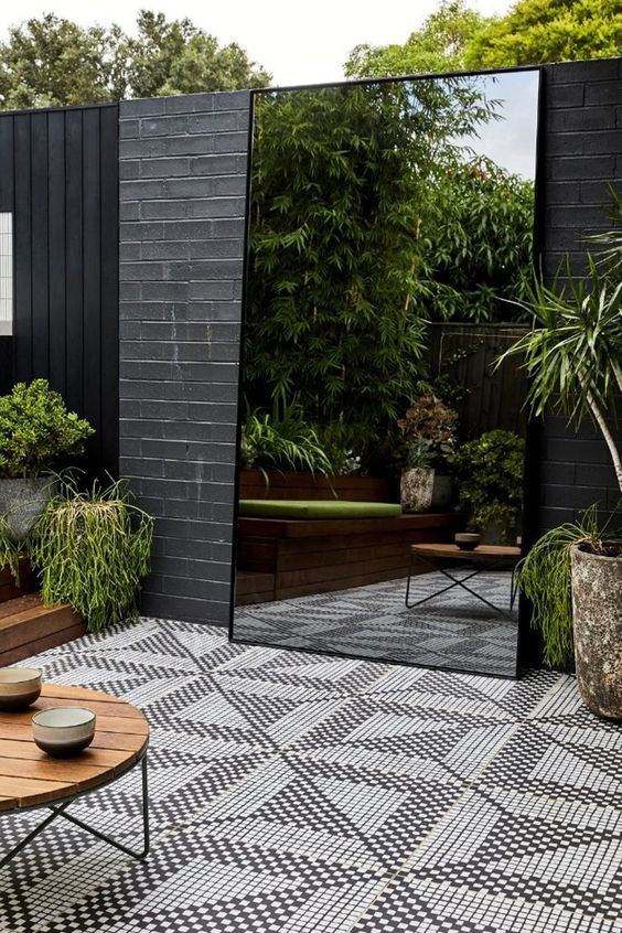 How to use plants and greenery to make the most of your small outdoor garden space.