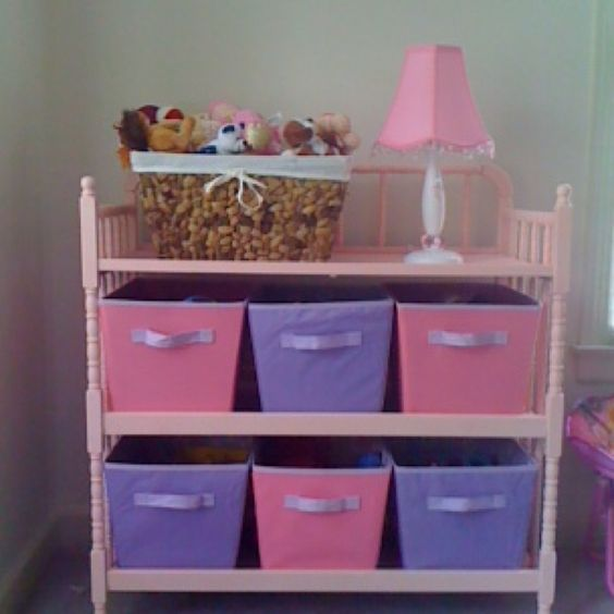 Lizzy's old changing table. Painted pink and is now a toy shelf/storage unit!