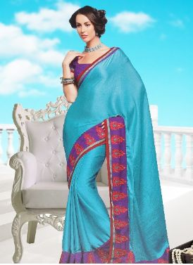 Ravishing looking silk Indian clothing in bluish green color for your charming and beautiful personality. The Indian clothing made in crush silk has smooth and elegant feel.