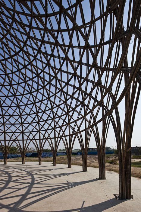 Diamond Island Community Hall in Vietnam by Vo Trong Nghia | So far two of the 24-metre-wide domes have their structural framework in place, creating a woven lattice made up of clusters of bamboo stalks.: