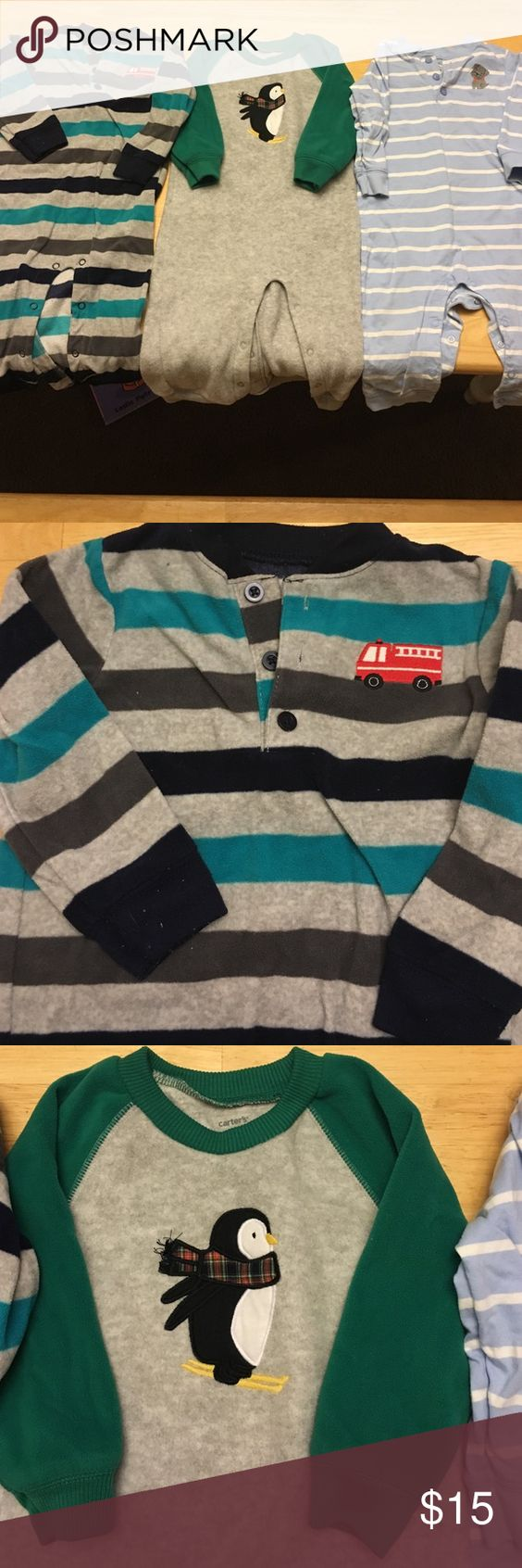 3 Footless 18 month Boys Carters Pajamas 3 pairs of button boy's footless pajamas. 2 wool and one cotton. Striped fire truck, green and grey penguin and white and blue puppy. Adorable and great shape, no rips or stains. Can split but would like to ship as a group. Carter's Pajamas Pajama Sets