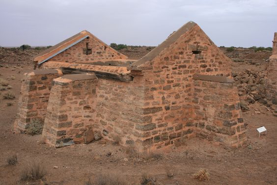 Stone buttressed water tank, at ruins of Overland Telegraph Station, South Australia, c.1880