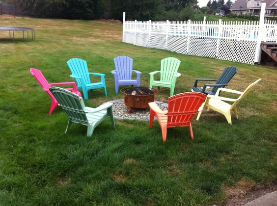 Adirondack chairs eight different colors all around the for Different color chairs