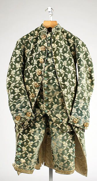 This suit, known as a ditto suit, was worn by men in the in the 18th century. When the waist coat, jacket, and breeches are all made out of the same material it is referred to as a ditto suit.