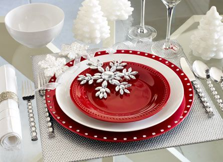 Embossed Silver Placemat • Red Lacquer Jeweled Charger • New Luminous Coupe Dinner Plate • Spice Route Paprika Round Salad Plate • Glitzy Gem Snowflake Ornament • Deluxe Porcelain Cereal Bowl • White Pintuck Napkin with Silver Bangle Napkin Ring • Calypso Flatware • White Tree LED Candles