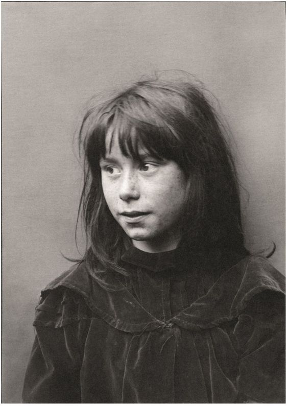 Early 1900 taken by Horace Warner - Spitalfields Nippers - A girl wears a fine dress from an earlier era, probably obtained at the nearby Houndsditch rag market