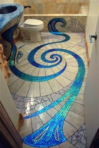 Beautiful mosaic floor, love how it goes up the sink!