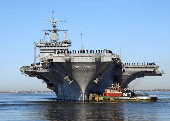 USS Enterprise approaches its pier at Naval Station Norfolk, Virginia. Wikimedia…