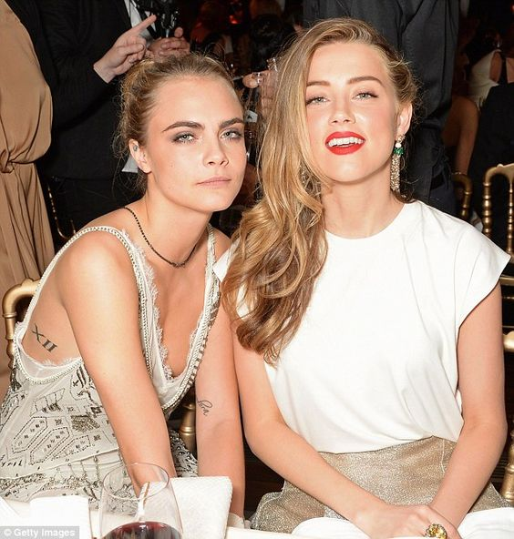 Johnny Depp's marriage to Amber Heard fell apart after he was 'driven insane' with fear that his bisexual wife was cheating on him with Cara Delevingne, it has been reported (Heard pictured with Delevingne in 2014)