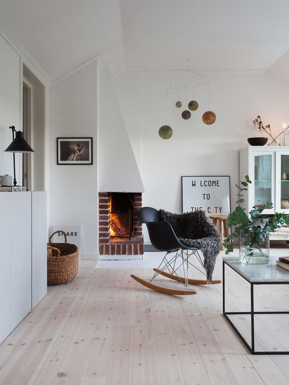 Black and white living room with bohemian decor, Scandinavian style, knotty pine floors, and modern furniture. #blackandwhite #livingroomdecor #bohemian #scandinavian #swedish #danishrocker #modern #decorinspiration