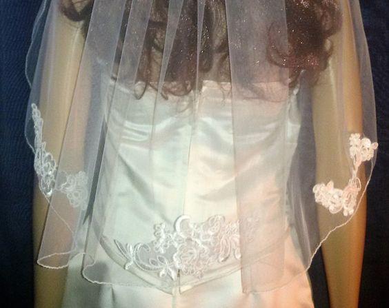 Waist length ivory lace edged veil