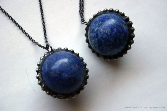 One necklace, featuring a large lapis lazuli round crystal ball sphere, set in an artistic handmade silver alloy solder setting. The pendant hangs from a gunmetal plated chain brass chain.  Chain measures about 28 long and has a lobster clasp with a mother of pearl crescent moon detail. Pendant hangs about 1.5 long including the bail.  You will receive one of the exact items pictured.