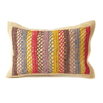 Fair Trade Multicolor Rafia Pillow. These vibrant crocheted and macraméd pillows not only bring the beach chez vous, but they're handmade by artisans in Madagascar in a Fair Trade agreement. They're perfect decor for a summery inn-by-the-sea feel or scattered casually across your sofa.