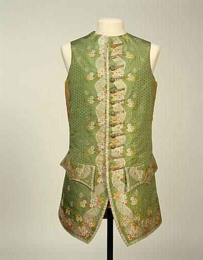 Waistcoat, 1755-1765, England, silk and silver thread woven spot and brocaded silver sprig. Floral border brocaded in silver and silk in shades of pink, mauve and green; back green glazed woollen satin; back and front to waist lined white cotton and linen; front edges and skirt lined cream wool fronts fastening with twelve silver thread covered buttons and buttonholes from round neck to waist seam; pocket at waist seam each side, white cotton and linen. | Collection - Manchester Art Gallery