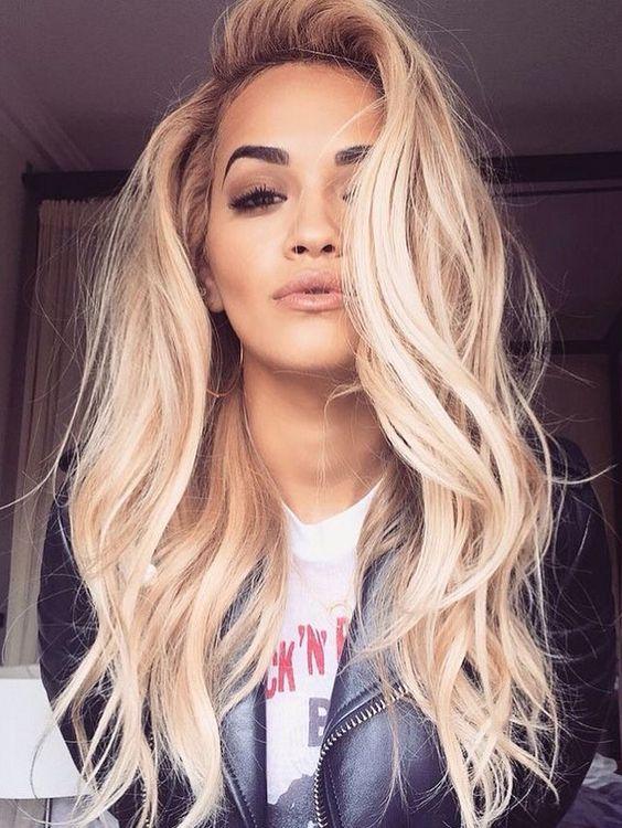 Rita Ora always proving how gorgeous blonde hair pairs with brown eyes. Love this.