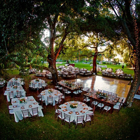 Lights from trees outdoor reception and different tables for Outdoor dance floor ideas
