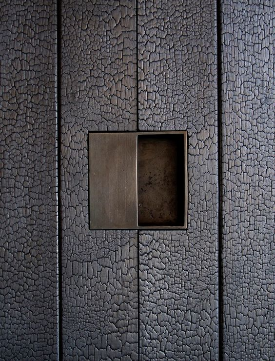 dust db custom door hardware in the shou sugi ban walls