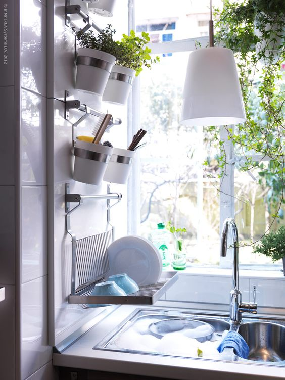 Hanging plants and fold down wall dish rack by sink for Kitchen drying rack ikea