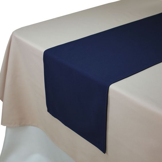 Blush Tablecloths and Navy Blue Table Runners.