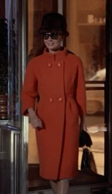 Audrey Hepburn's 60's orange coat in Breakfast at Tiffany's.