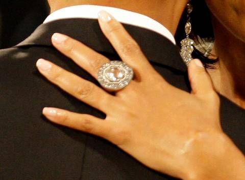 First Lady Michelle Obama S Ring Is Seen As She Dances With President Barack Obama At The Obama Home States Inaugural Ball On J Obama Ring Bling Michelle Obama
