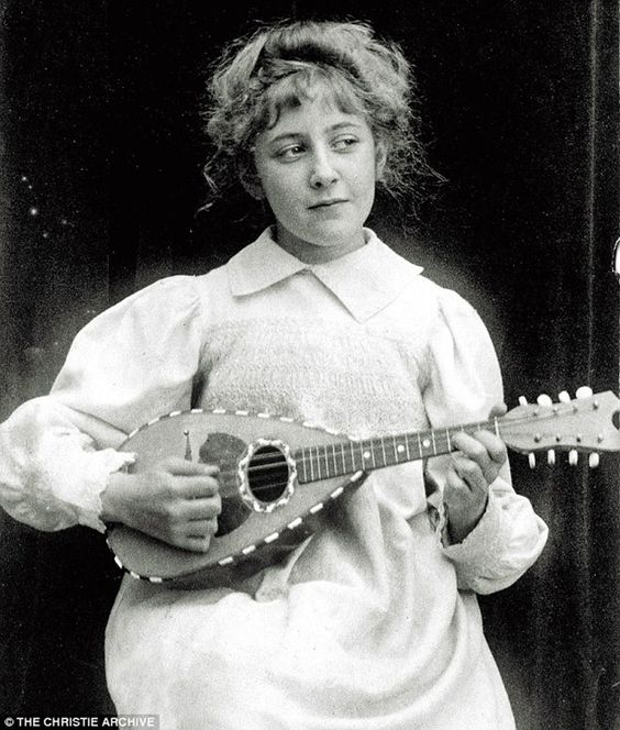 The young Agatha playing the mandolin, aged 8 in 1898..... vintage everyday: 13 Rare Photos of The Queen of Crime Agatha Christie
