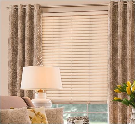 Graber wood blinds combined with a print grommet curtain on a ...