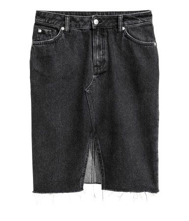 Black denim. 5-pocket skirt in washed denim with distressed details. Zip fly with button, opening at front, and raw-edge hem.