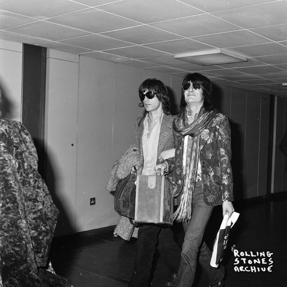 Mick and Ronnie arrive at Heathrow Airport, London after recording at Musicland in Munic in 1973.
