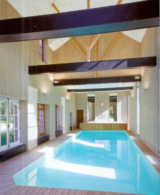 Swimming Pool Elegant Indoor Pool With Wood Deck Also Wood Wall