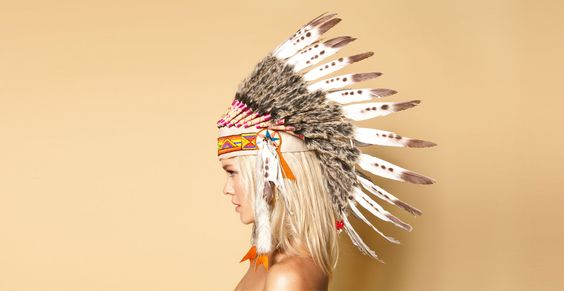 I pinned this just because I think it's funny that that beautiful headdress is on the whitest girl possible.