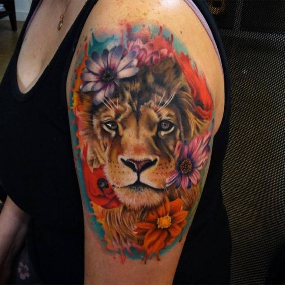 Nice looking colored shoulder tattoo of lion with flowers