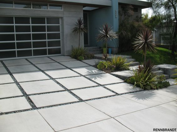 The Driveway Looks Magnificent With The Concrete Tiles And