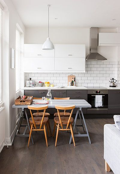 Homes neon: White and minimal London flat - the dining table with Ercol Stacking Chairs http://www.nest.co.uk/product/ercol-stacking-chair