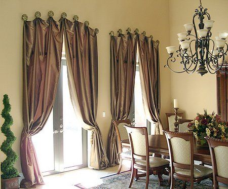 A creative way to hang your drapes window treatments for Unusual ways to hang curtains