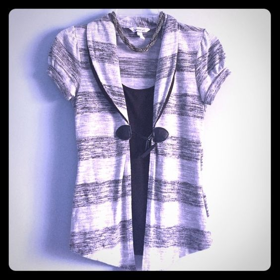 Short sleeve cardigan like with attached tank Bought this for me daughter who has never worn it.. Not her style. Very cute puffed sleeve grey and black with black attached tank underneath. Speechless Jackets & Coats Blazers