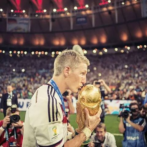 The World Cup trophy finally receives a kiss from a real Fussballgott. #bastian #Schweinsteiger #weltmeister #bs31 #WorldCup #Germany #DieMannschaft