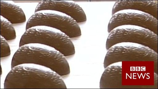Mass production: A tour of the Cadbury's factory in Bournville, Birmingham, as Easter eggs roll off the production line. It explains the process of producing the chocolate eggs on a production line. The liquid chocolate is poured into moulds and the two halves are joined before being wrapped in foil. The entire process is mechanised.