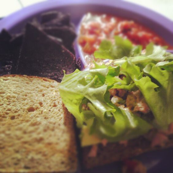 Lunch box ideas for Adults Tuna sandwich on whole grain with blue corn chips and salsa.