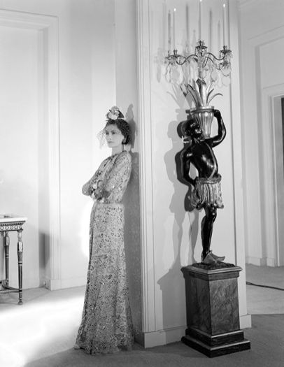 Coco Chanel and a blackamoor.  Love Chanel and now obsessed with these gorgeous Venetian standing lamps. Both in one picture!!