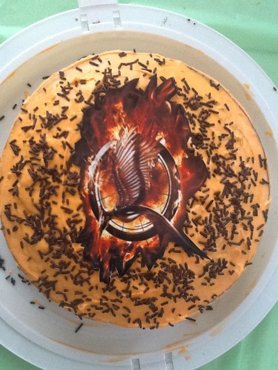 Such a great idea for a catching fire birthday. Homemade cake with a cut out picture in the center