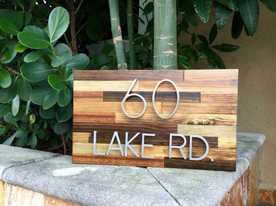 Reclaimed wood address plaque with numbers and letters.