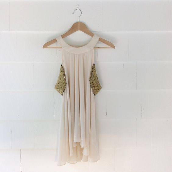 Embellished Blouse Blouse with open shoulders and gold embellished off the shoulder sleeves. Can wear as a top or longer tunic style. Very elegant and pretty. Been worn 1-2 times and is in great condition. Forever 21 Tops Blouses
