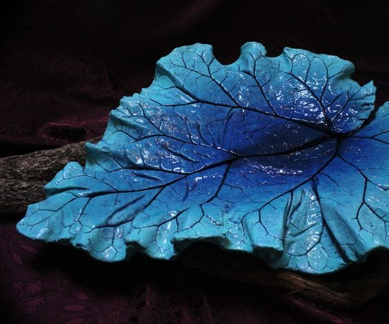 I enjoy making these leaf castings. My dad was a bricklayer, I love to garden, and it is fun! These leaves can be used both indoors and outdoors.Materials:Mixing tub and mixing trowelLeafSandWaterPiece of sheet plastic Concrete Mix