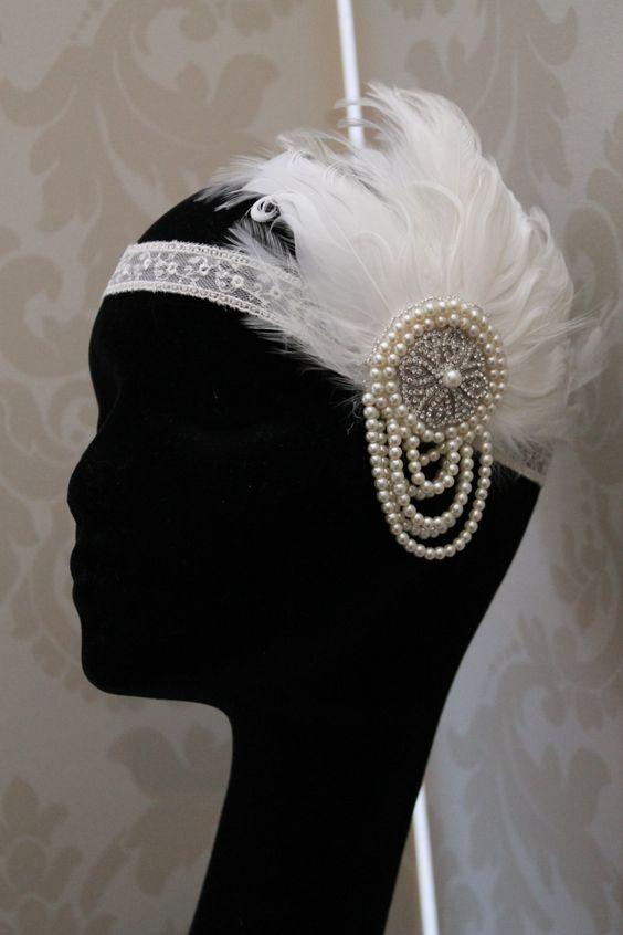 Handmade handbeaded bridal feather headdress wedding headpiece vintage style 1920s flapper style ivory Bridal headdress. £69.00, via Etsy.
