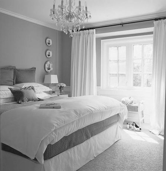Beautiful grey-white bedroom: Simple and elegant with crystal chandelier. #painters #decorators #builders #tilers #London #bedroom #chandelier
